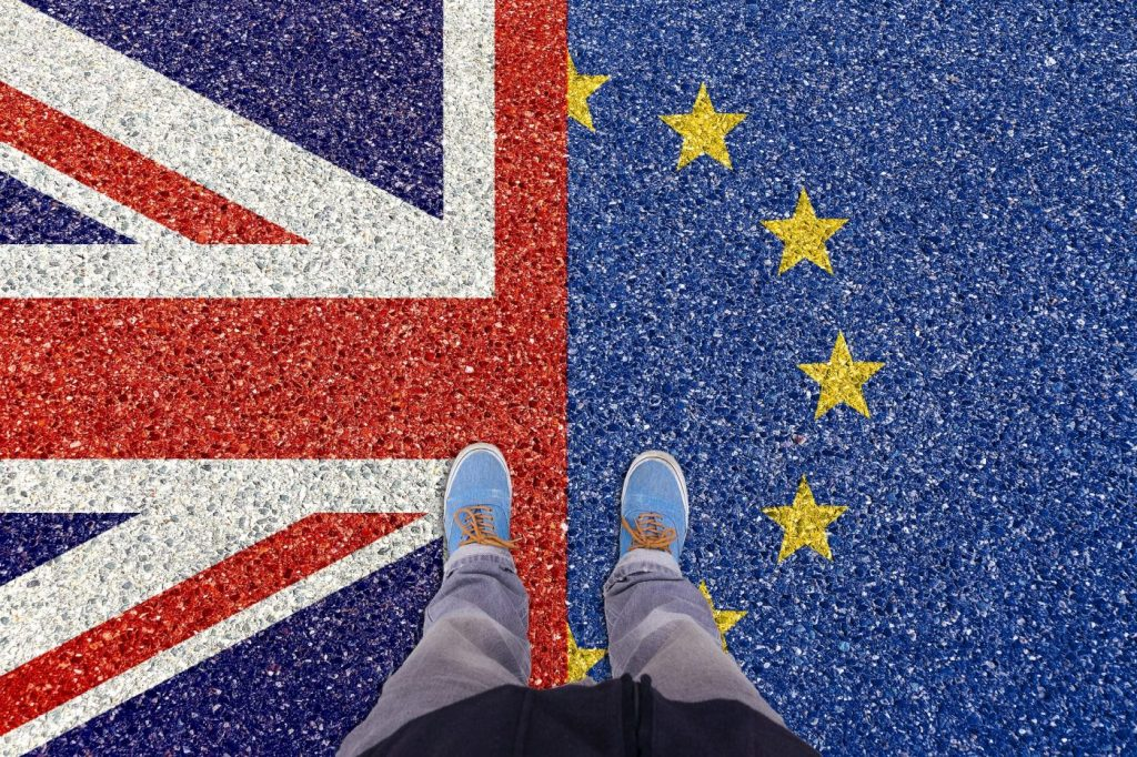 standing on the union jack and eu flag